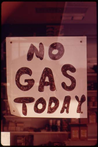 In this Oct. 1973 photo, a sign hangs in the window of a gas station in Lincoln City, Ore.