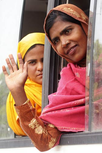 Ashiya (L) and Rajya (R) gesture before leaving India.