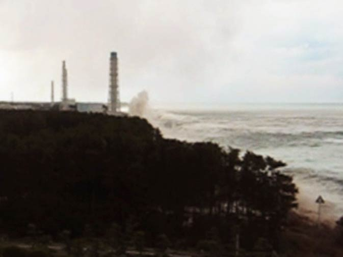 Tsunami waves hit the sea-wall at the Fukushima Daiichi nuclear power plant in this image, released by Tokyo Electric Power Co (TEPCO) one month after the disaster. – Photo by Reuters