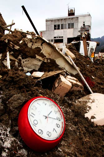 A broken clock sits in the debris on Monday, two hours before the recent earthquake struck Japan at 5.16 pm. – Photo by AP