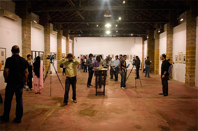 A wide view shows the cavernous space of the gallery, which was originally a large warehouse. On its first day, the exhibition was visited by almost as many media personnel as art enthusiasts.