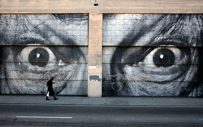 A man walks past the outside wall of the 'Art In The Streets' exhibit at the Geffen Contemporary at the Museum of Contemporary Art in Los Angeles, California, May 5, 2011.