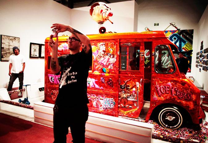 A man photographs the exhibit.