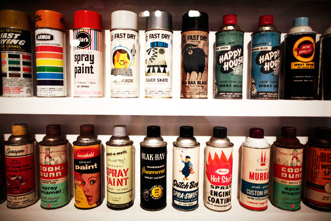Spray paints are displayed at the exhibit.