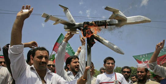 Activists of Pakistan Tehreek-e-Insaaf (PTI) hold up a burning mock drone aircraft during a rally against drone attacks in Peshawar May 13, 2011. - Reuters Photo