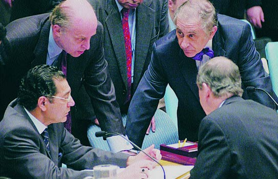 Pakistan's Permanent Representative to the UN Munir Akram (bottom left) in negotiations with western diplomats. - File Photo (Thumbnail illustration by Hasaan Haider/Dawn.com)