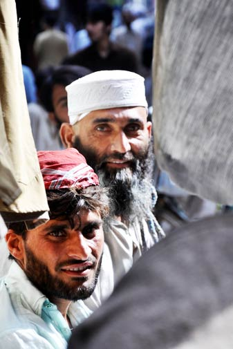 Men in the marketplace in old city Peshawar.