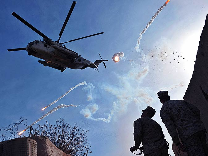 A US Marine CH-53 helicopter drop flares as it leaves Musa Qala in Helmand province, Afghanistan, on December 14, 2010. – Photo by Massoud Hossaini/Herald