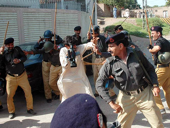 Police lathi (riot stick) charge media men as they cover a terror attack in Khyber-Pakhtunkhwa. – Photo by Mohammad Zubair/ AP