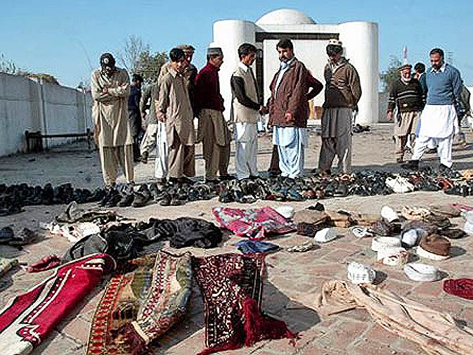 Prayer mats, slippers and prayer caps lie scattered shortly after a suicide bombing at a Sufi shrine in Khyber-Pakhtunkhwa. – Photo by Mohammad Zubair/ AP