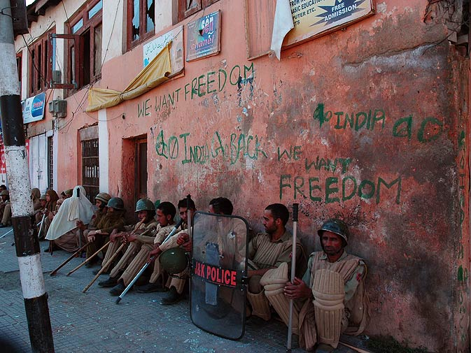 Armed forces personnel take a break during the rioting in Shopian, Indian-administered Jammu and Kashmir, in 2010. – Photo by Dilnaz Boga/Herald