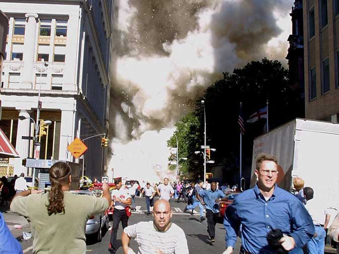 This file photo taken on September 11, 2001 shows pedestrians running from the scene as one of the World Trade Center Towers collapses in New York after a plane taken over by terrorists crashed into the Twin Towers. Two hijacked US airliners crashed into the twin towers of the World Trade Center, which subsequently collapsed. A third hijacked plane crashed into the Pentagon outside Washington and a fourth in rural Pennsylvania. ?  AFP (File Photo)