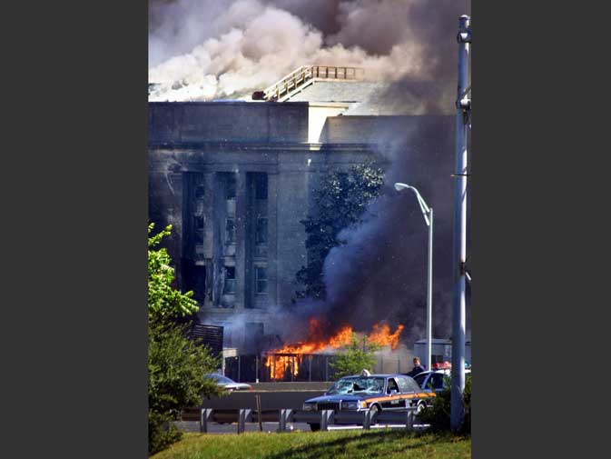The Pentagon is seen on fire after a hijacked aircraft crashed into it in this September 11, 2001 file photo.  The attacks killed around 3,000 people. ? Reuters (File Photo)