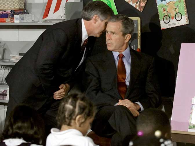 US President George W. Bush listens as White House Chief of Staff Andrew Card informs him of a second plane hitting the World Trade Center while Bush was conducting a reading seminar at the Emma E. Booker Elementary School in Sarasota, Florida in this September 11, 2001 file photo. ? Reuters (File Photo)