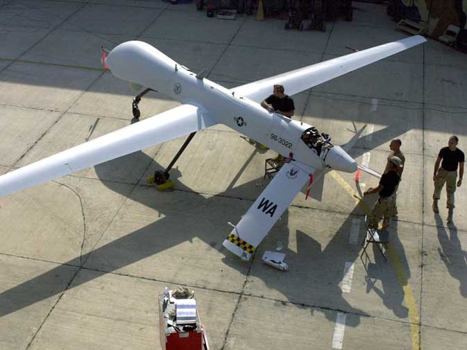 Members of the 11th Reconnaissance Squadron from Indian Springs, Nev., perform pre-flight checks on the Predator unmanned aerial vehicle prior to a mission, in this November 9, 2001 file photo shot at an undisclosed location. Pakistanis have long protested against the US drone campaign on the Afghan border, which stepped up under the Obama administration as it prepared to draw down troops in the 10-year war in Afghanistan. The air raids also go to the heart of the resentment that Pakistanis feel against the United