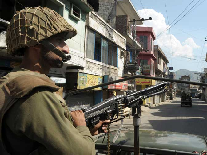 Pakistani army troops patrol on a deserted street in Mingora, the capital of Swat Valley, on May 27, 2009. At least 2,795 Pakistani soldiers have been killed in fighting since 2004. Another 8,671 have been wounded in the war against terrorism. ? AFP (File Photo)