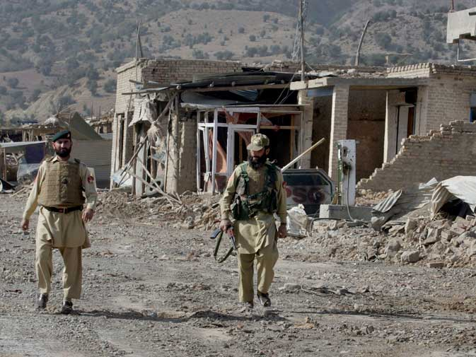 In this image taken on Nov. 17, 2009, Pakistani troops walk through the damaged market in Sararogha, a town of the troubled Pakistani tribal region of South Waziristan along the Afghan border. ? AP (File Photo)