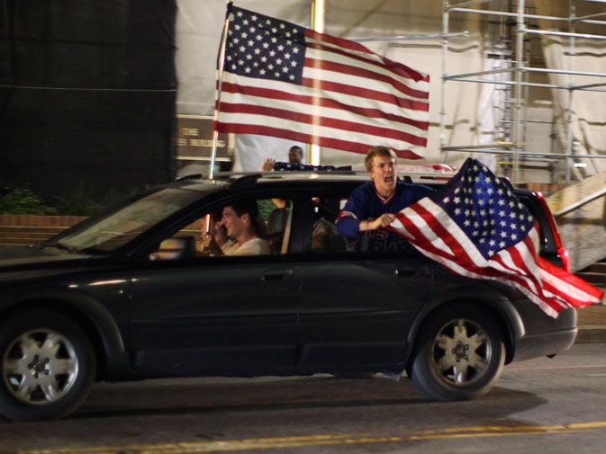 Revelers drive through the streets of Washington waving a US flag after US President Barack Obama announced live on television the death of Osama bin Laden, May 1, 2011. The news was hailed by governments around the world but many cautioned that the fight against extremism was not over. ? Reuters (File Photo)