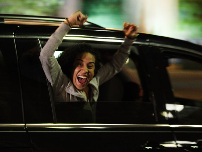 A reveler riding on a car cheers in Washington, late May 1, 2011, after US President Barack Obama announced live on television the death of Osama bin Laden. ? Reuters (File Photo)