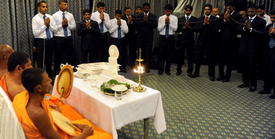 Sri Lankan squad receives blessings from Buddhist monks during a religious ceremony  prior to Sri Lanka team's departure for a tour of England. —AFP Photo