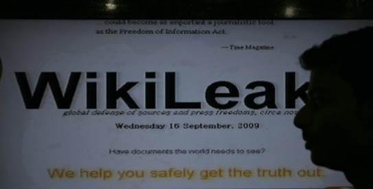 A man watches Wikileaks memos at an electronic shop in Karachi, Pakistan on Thursday, Dec. 2, 2010.-AP Photo