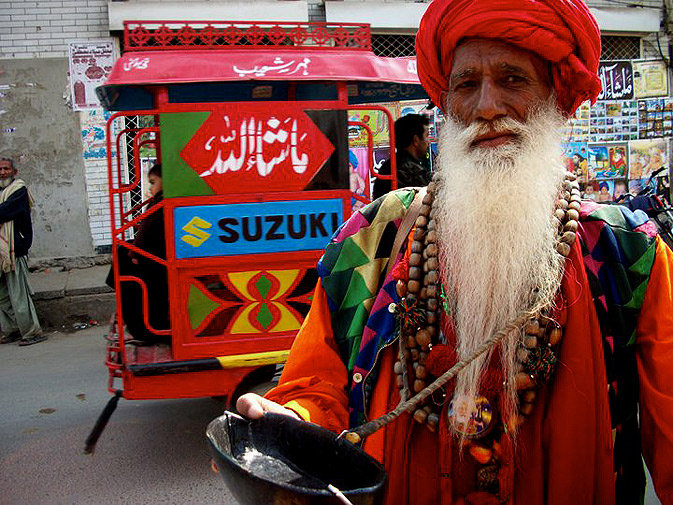A Malang outside the shrine of Bulleh shah with his alms bowl. Bulleh Shah's time was marked with communal strife between Muslims and Sikhs. Legend says, while Bulleh Shah was in Pandoke, Muslims killed a young Sikh man who was riding through their village in retaliation for murder of some Muslims by Sikhs.  Bulleh Shah denounced the murder of an innocent Sikh, maintaining that violence was not the answer to violence.  He was later censured by the Mullas and Muftis of Pandoke. He also hailed the ninth Sikh Guru, Gu