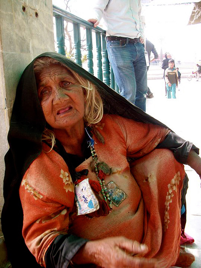 A beggar on the stairs of the shrine of Baba Kamal Chisti in Kasur.
