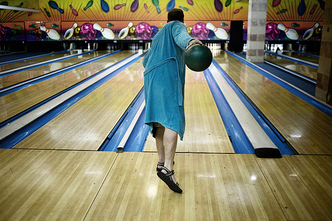 "A man bowls dressed as the movie character ""The Dude"". -Photo by AFP"