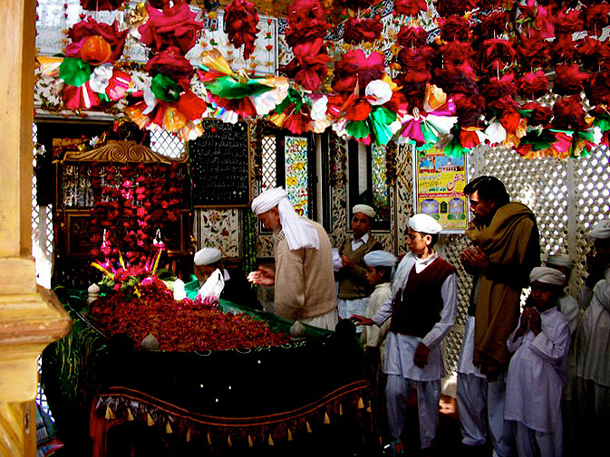 Devotees at the resting place of Bulleh Shah. The appeal of Bulleh Shah's verses has transcended generations and centuries because it breakdowns complex existential questions of life and society into simple solutions grounded in humanity.