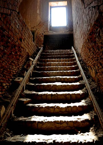 These stairs lead down to, possibly, the deepest underground passageway at the fort. The area below is itself enclosed in the dark and rumour has it that it was a secret passageway that led directly to Noor Mahal in the city of Bahawalpur. The stairs have tracks on either side showing that the passageway was used to transport goods (or people) over a very large distance.