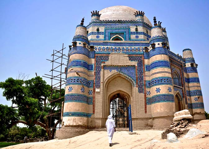 A man walks towards the tomb of Bibi Jiwandi.