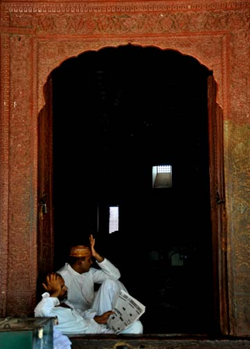 Caretakers of the shrine sit at the door of the darbar of Jalaluddin Bhukhari.
