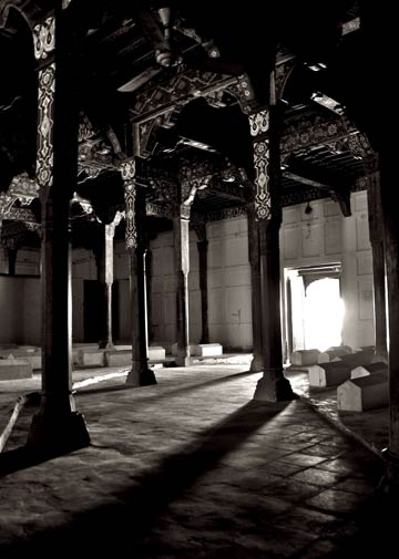 The entrance of the darbar of Jalaludin Bukhari as seen from the inside. Intricate wood work and pillars constitute the shrine's architecture.