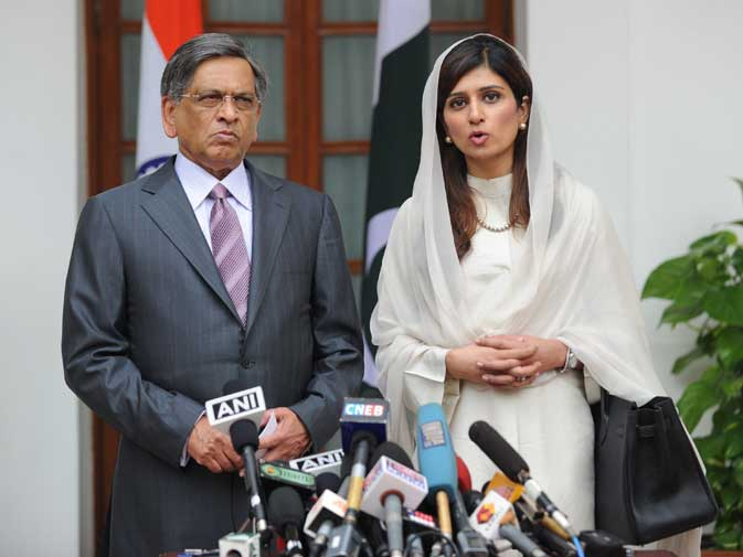 While Pakistan's FM said important things, Krishna's mind wandered over to Khar's meeting with the Kashmiri separatists. The Indian government sources and Krishna's face says it all - the talks did sour the atmosphere ahead of peace talks after all! ? AFP photo