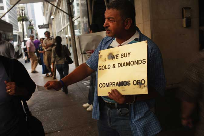 A man tries to attract customers in the jewelry district on August 18, 2011 in New York City. As the price of gold continues to soar, gold buyers in the district have been doing a brisk business as individuals look to sell their gold while prices are high. Gold is currently selling for around $1820 an ounce.