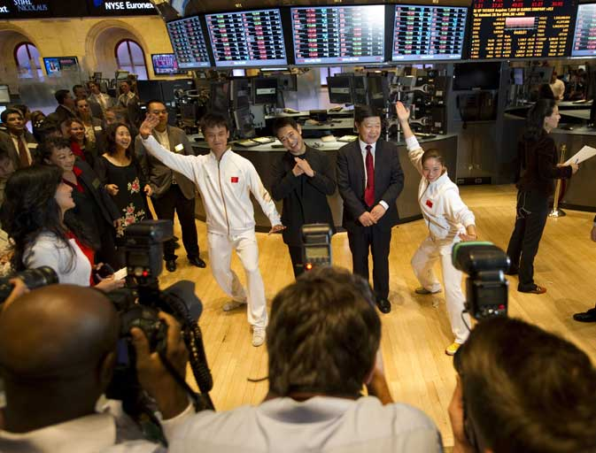 Chinese actor Jet Li (C) with officials from the Chinese Wushu Association on the floor of the New York Stock Exchange on August 18, 2011 in New York. The Dow Jones Industrial average ended up closing down approximately 420 points. The Dow Jones Industrial Average closed down 419.63 points (3.68 per cent) to 10,990.58, following an earlier rout on Europe's bourses. The broader S&P 500 sank 53.23 points (4.46 per cent) to 1,140.65, while the tech-heavy Nasdaq Composite was hit harder by selling, tumbling 131.05