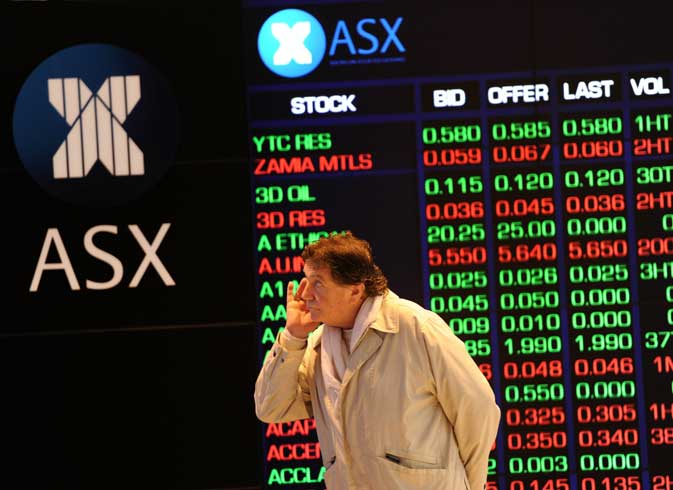 An investor reacts to steep falls on the Australian Stock Exchange (ASX) in Sydney on August 19, 2011. Australian stocks slumped 2.75 per cent following steep falls on international markets amid new worries that Europe and the US  are sinking into recession.