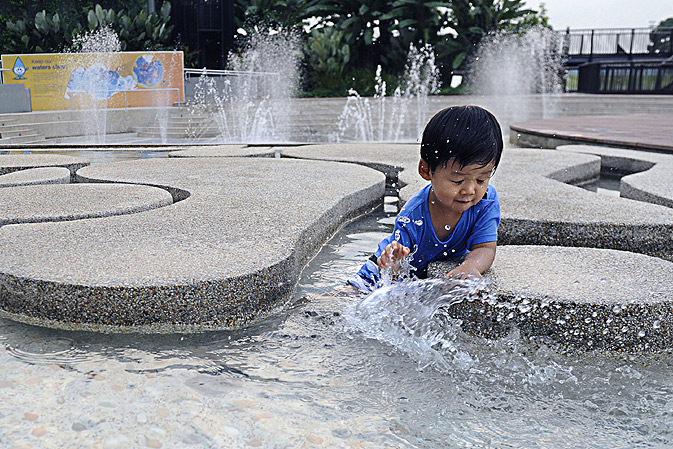 A boy plays with water at Singapore's Lower Seletar Reservoir.