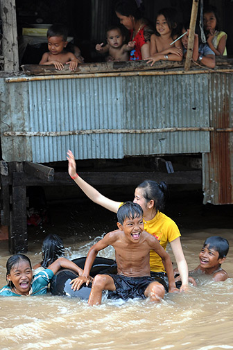 Cambodian children play in the water in Kandal province.