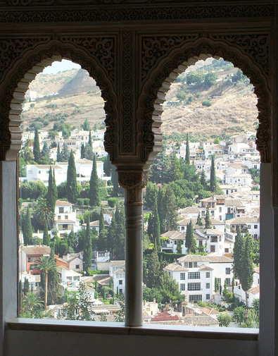 "A window overlooking Albaicín from the Oratory of the Mexuar (Arabic: Al-Mashwar), the Council Chamber. It is said that the last Moorish king of Granada, Abu Abdullah Muhammad XII (1460-1527) sighed as he was leaving Alhamra. His mother rebuked him in these famous words: ""He should not cry like a woman for a place he could not defend like a man."""