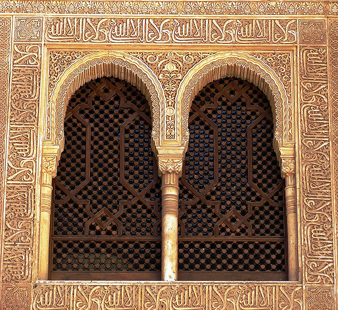 Paired windows in wooden grillwork with horseshoe arches are a common occurrence throughout the palace. This pair looks over the Golden Quarters and the gaze naturally centers upon the marble fountain in the middle of the floor.