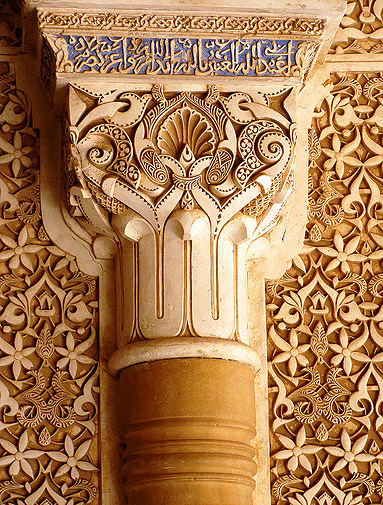 Floral and orthographical details of a column in Court of the Lions.