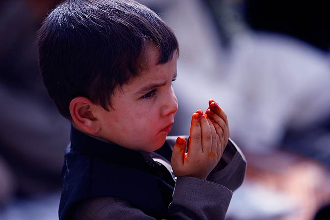 An Afghan boy offers prayers during Eid-ul-Fitr in Kabul on Tuesday. - AP Photo.