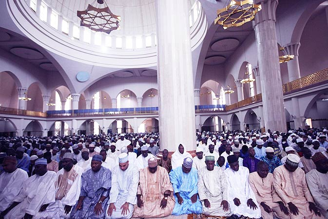Nigerian Muslims offer prayers at the central mosque in Abuja, Nigeria. - AP Photo.
