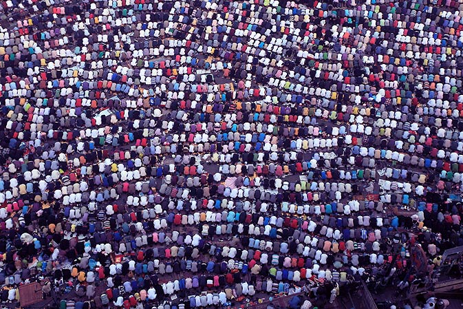 Thousands of Egyptian Muslims gather to pray, celebrating Eid, in Tahrir Square on Tuesday, in Cairo. - AFP Photo.