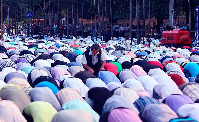 Albanian Muslims take part in early-morning Eid prayer in the capital Tirana on Tuesday. - AP Photo.