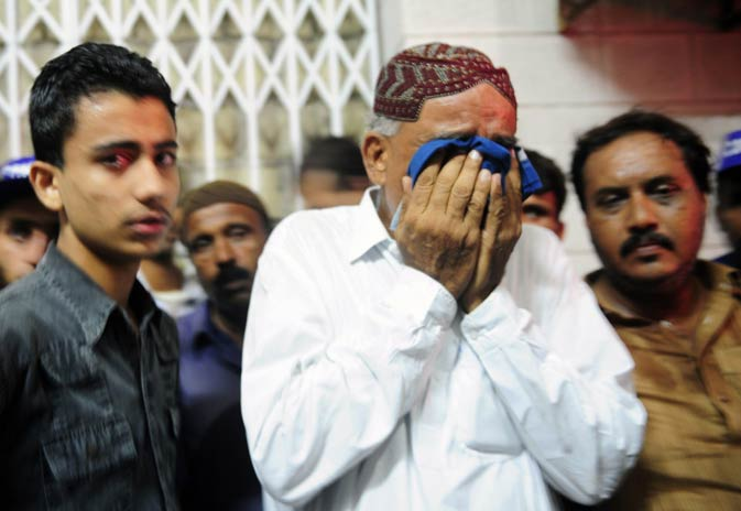 Relatives mourn the killing of Waja Karimdad, a former MP, belonging to the ruling Pakistan Peoples Party (PPP), who was shot dead by a criminal gang, at a hospital.