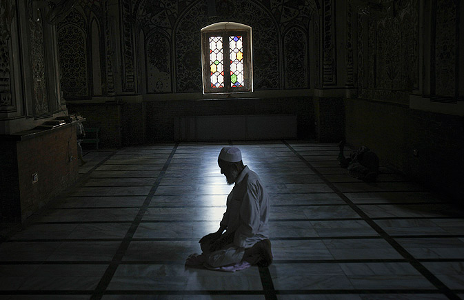 A man offers midday prayers in Mohabbat Khan mosque in Peshawar.