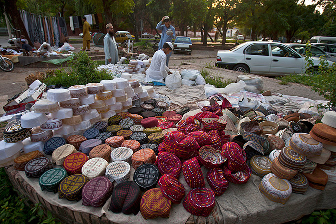 Muslims buy traditional caps at a stall as they prepare for the upcoming Ramazan in Islamabad.