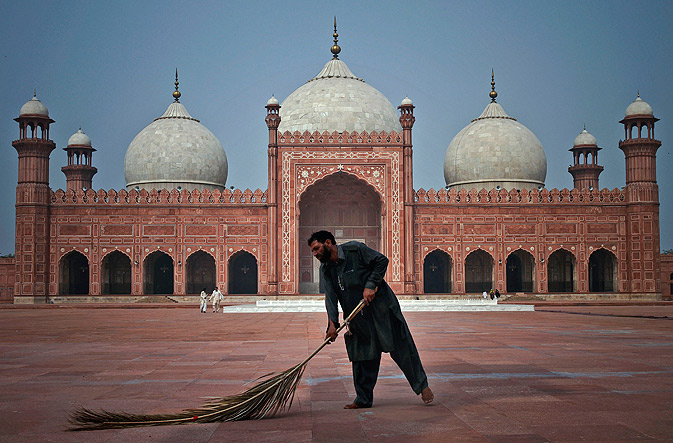 A worker cleans the floor of the historical Badshahi mosque in preparation for the upcoming Ramazan in Lahore.